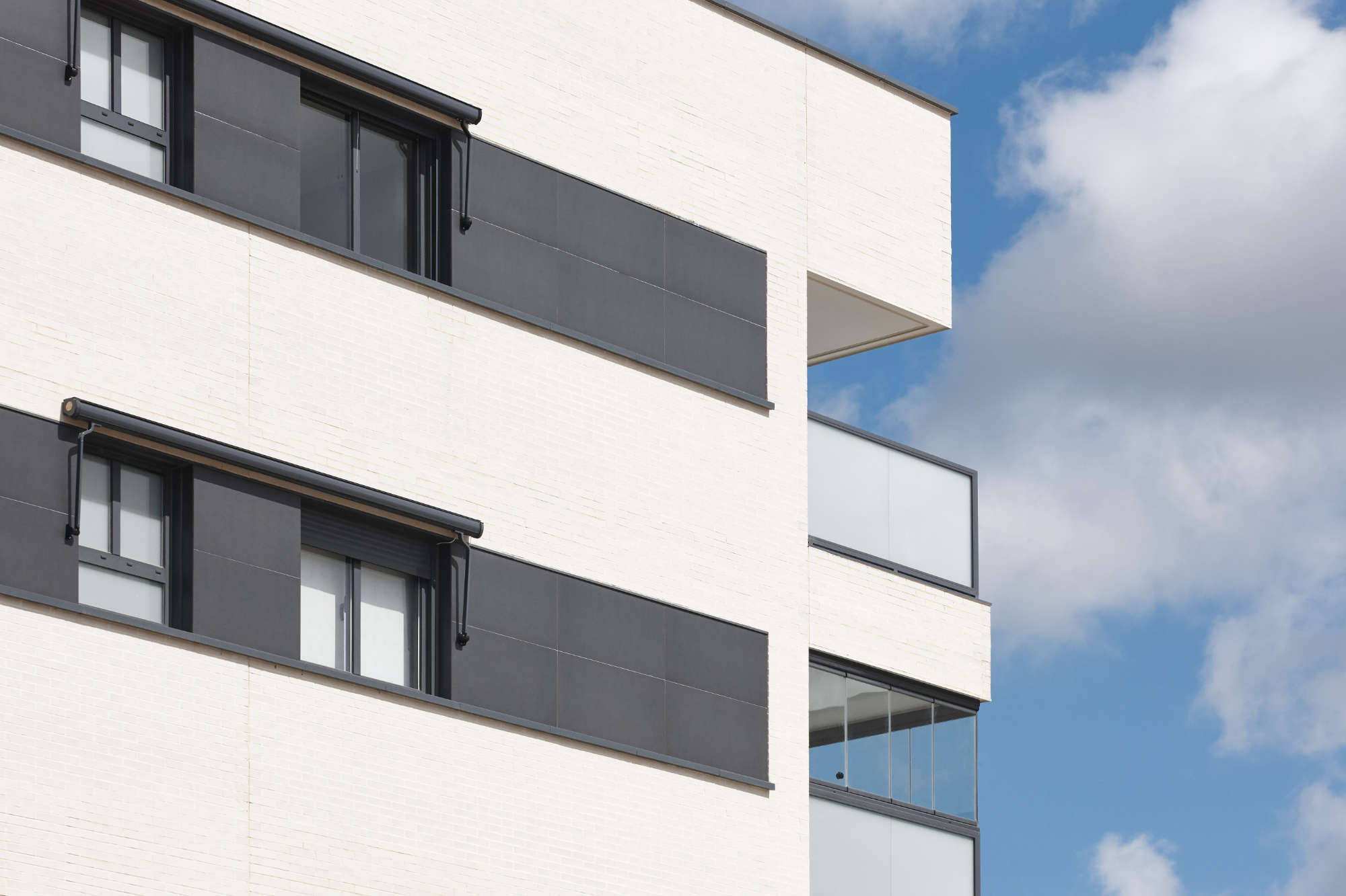 new-building-exterior-facade-with-terrace-construc-2ZYN4DS.jpg