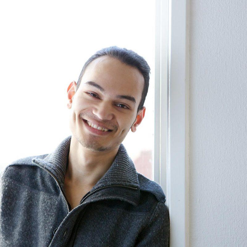 young-asian-man-smiling-at-home-PBGE75L.jpg
